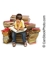 Reading book - Photo of young boy reading a book while ...