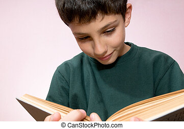 Reading boy with a book