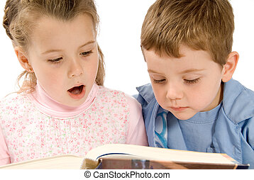 Reading - brother and sister reading a big book