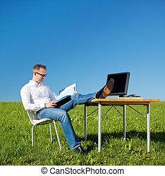 Reading businessman