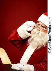 Reading Christmas wish list - Portrait of Santa Claus...