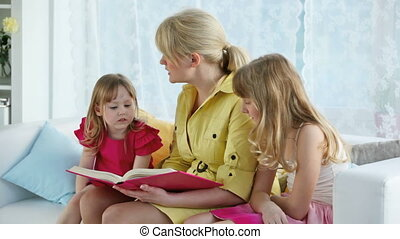 Reading fairy-tale - Mother reading a fairy-tail to her...