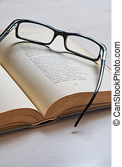Reading glass on an old book