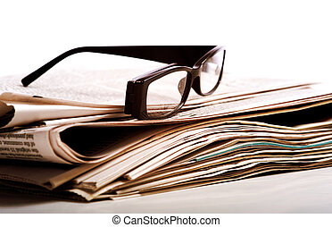 Reading Glasses on Newspapers