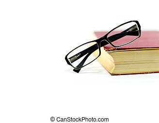Reading glasses on old book