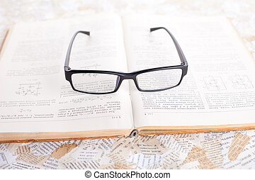 reading glasses on opened book