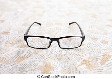 reading glasses on paper background