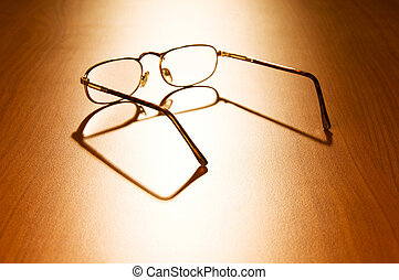 Reading glasses on the wooden table