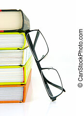 Reading Glasses - Reading glasses and books isolated against...