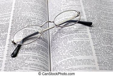 Reading Glasses - Reading glasses on open dictionary book