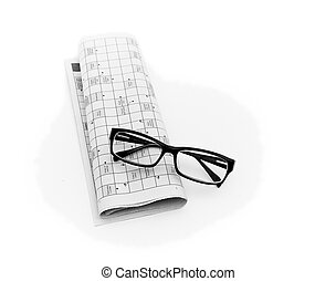Reading glasses sitting on a newspaper with
