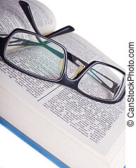 Reading glasses with books isolated on the white