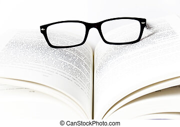 Reading glasses with books