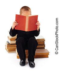Reading Literature - Kid with book in hand sitting and...