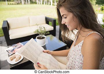 Reading news in the garden
