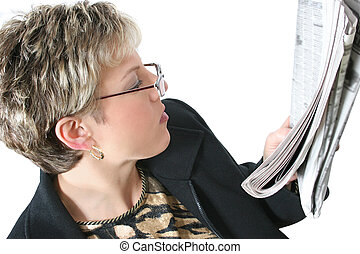 Reading Newspaper - Woman reading newspaper. Shot with the...
