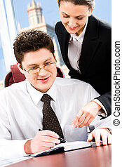 Reading notes - Portrait of two business people in the...