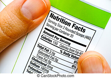 Reading nutrition facts on protein jar.
