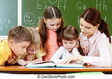 Reading - Portrait of smart schoolchildren and their teacher...