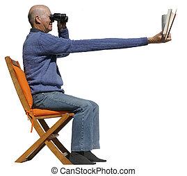 Short sighted man needs binoculars to read his book