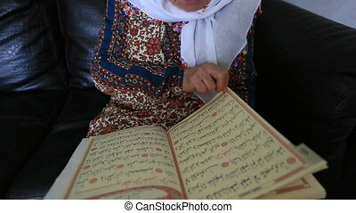 reading Qur'an 2 - Muslim women reading Holy Qur'an