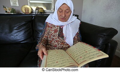 reading Qur'an 3 - Muslim women reading Holy Qur'an