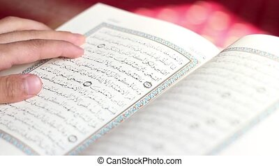 Reading Quran in Mosque - A man is reading Quran on the...