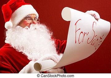 Reading Santa - Portrait of Santa Claus reading big letter...