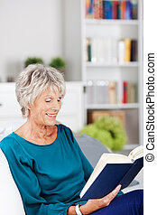 Reading senior woman