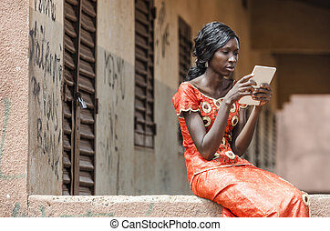 African Black Ethnicity Woman Reading On Tablet Computer -...