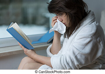 Reading the romance and crying - Sensitive young woman ...