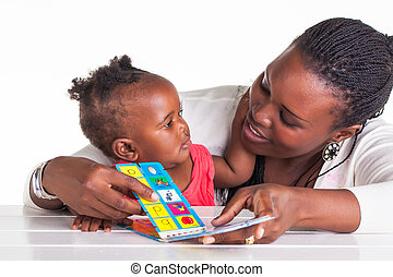 Reading time - Mother and daughter are having some ...