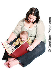 reading to baby - mother reading to her infant child. Its a ...