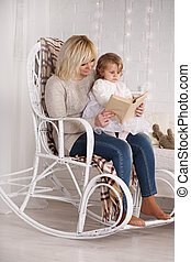 reading to her daughter