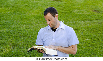 Reading with hand on Bible