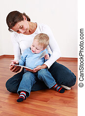 Reading with mom - Smart little boy reading with mom or...