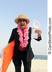 ready for a holiday: businessman on the beach with air...