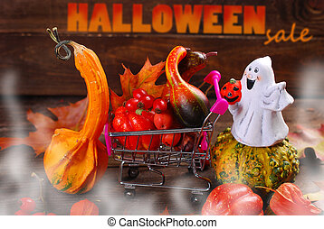 ready for halloween - shopping trolley packed with autumn...