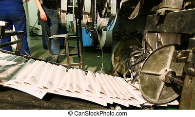 ready newspaper on production line in a print shop