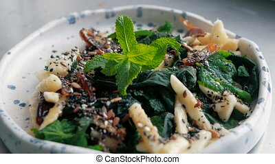 ready salad from the chef with nettles, banana, dried fruits