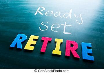 Ready, set, retire! Colorful conceptual words on blackboard.