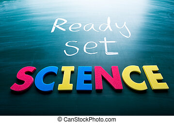 Ready, set, science! Colorful conceptual words on blackboard.