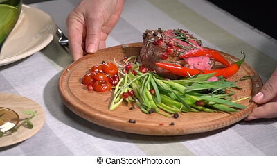 Ready steak served on the table. slow motion - Ready steak...