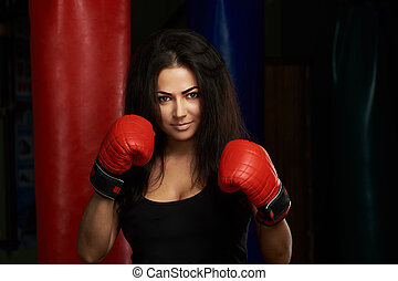 Ready to boxing young woman