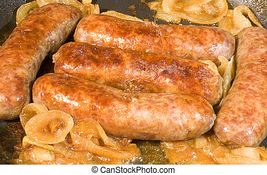 bratwurst that have cooked slowly with yellow onions
