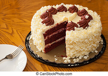 Red velvet cake on the table with a fork and spoon