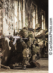 Ready to fire a shot - Soldiers in camouflage clothes and...