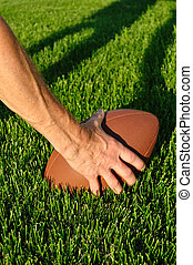 Ready to Hike Football on a grass playing field