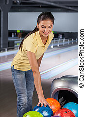 Ready to play. Women holding a bowling ball