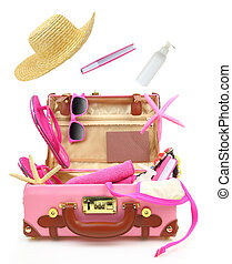 Ready to travel open pink suitcase with summer equipment